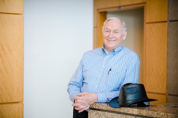 Don Konemann, on the job with his trademark cowboy hardhat, says he still loves what he does.