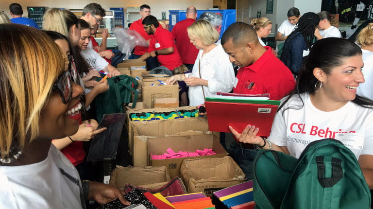 Employees pack backpacks in Philadelphia