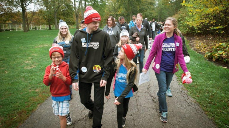 SCID patient Aiden Walsh walks in support of the Immune Deficiency Foundation