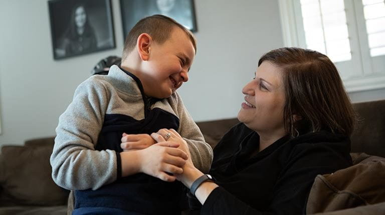 Alison Bartko with her son, A.J., who is living with congenital afibrogenemia