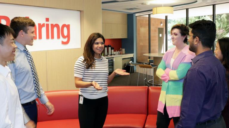 Aneesa Bey, member of the CSL Behring University Relations team, talking with interns