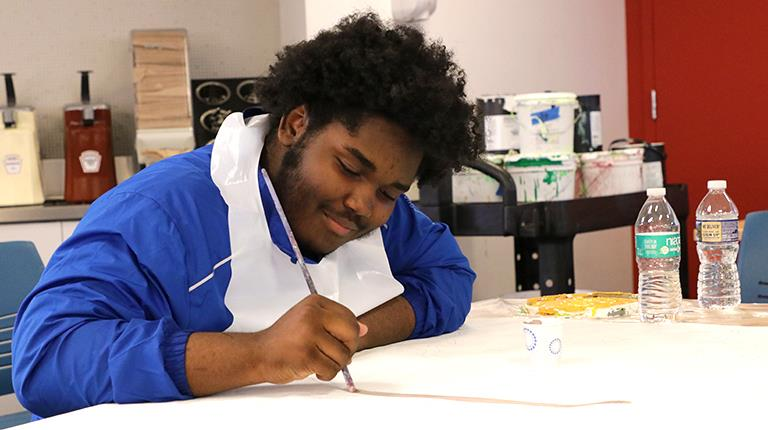 Philadelphia high school student paints at biotechnology leader CSL Behring's King of Prussia campus