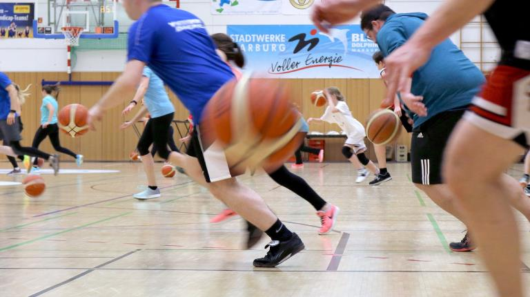 CSL Behring employees participate in basketball drills with local professional players