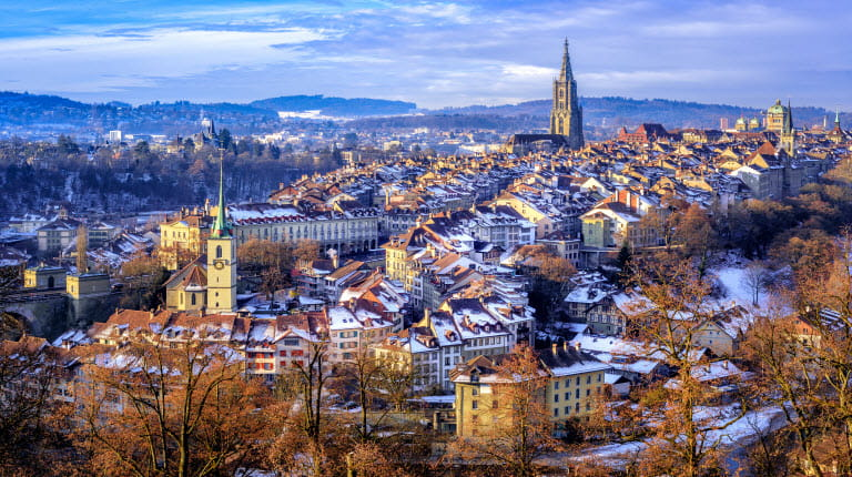Bern Switzerland in winter with snow on rooftops