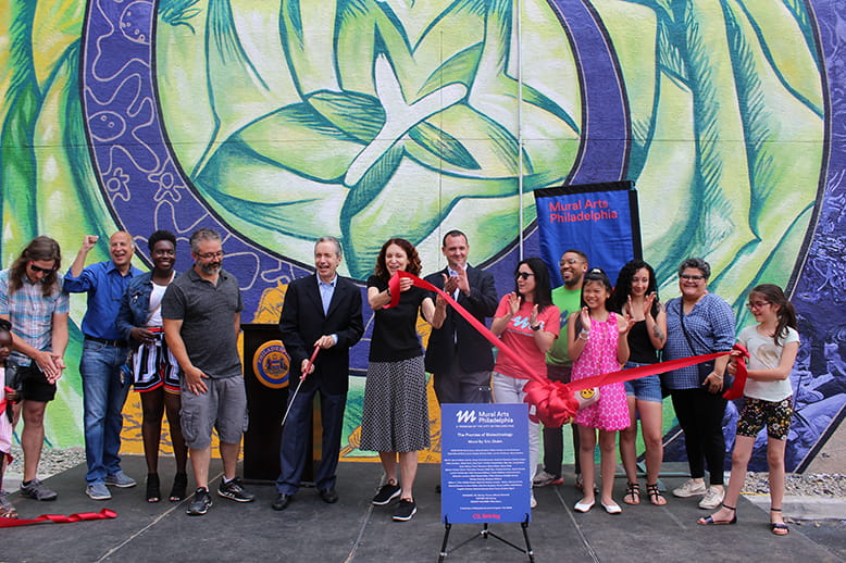 Leaders and artists cut the ribbon on CSL Behring biotechnology mural in Philadelphia