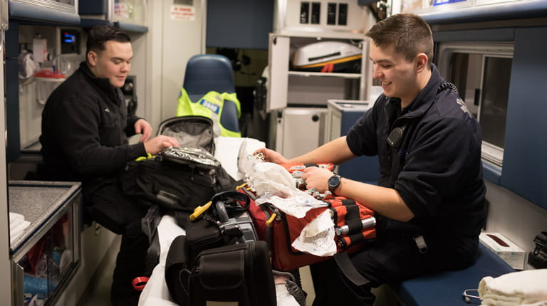 Paramedic brothers Brady and Cody Kunkel in ambulance.