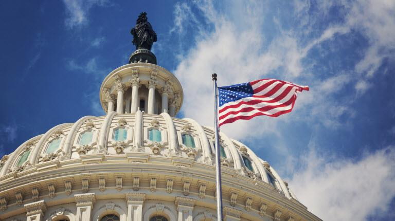 Flag files over the U.S. Capitol in Washington