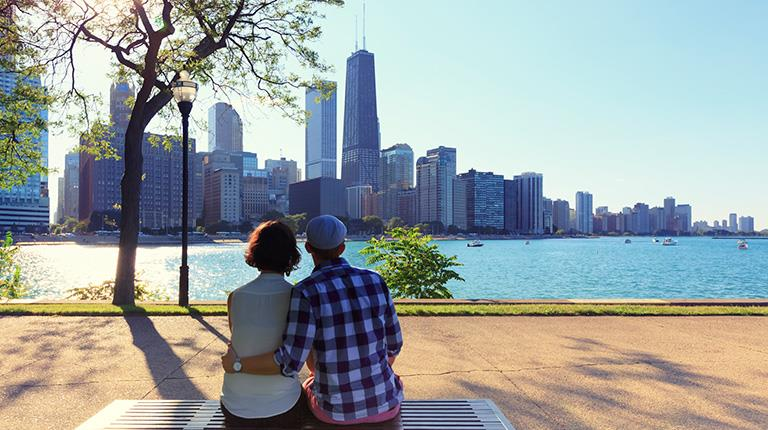 A couple sitting on a bench looking at the skyline of Chicago, where CSL Behring was honored recently by the Bleeding Disorders Alliance of Illinois (BDAI) with its 2018 Outstanding Support Award.