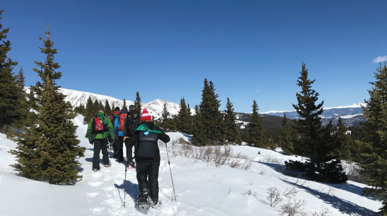 CSL Behring employees climbing snowy mountain in Colorado