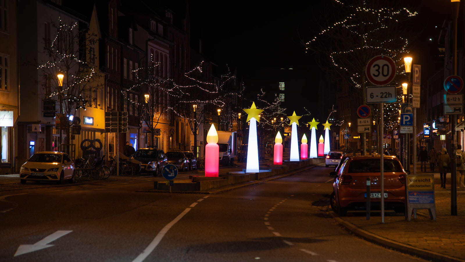 large candles light up a Marburg street