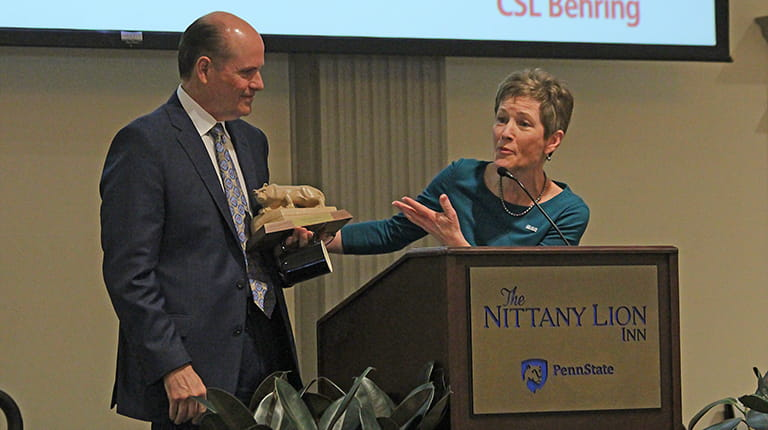 CSL CEO and Managing Director Paul Perreault accepts a Nittany Lion statuette from moderator Carolyn Donaldson following his remarks on the campus of Penn State University in University Park, Pennsylvania, as part of the university's Forum Speaker Series.