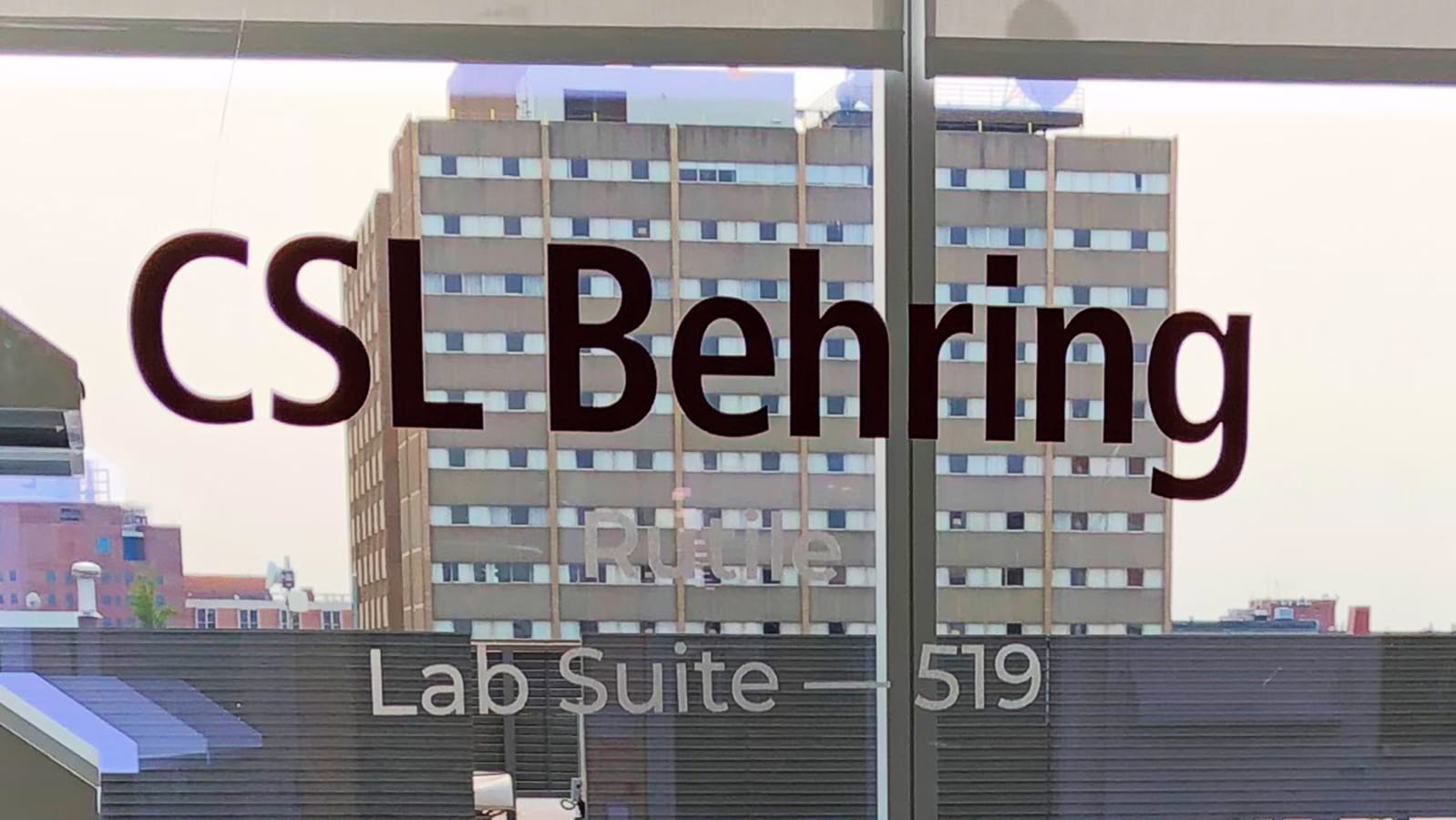 CSL Behring logo on the window of University City Science Center lab in Philadelphia