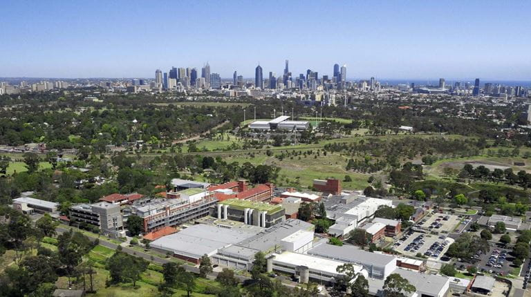 Photo of CSL's Parkville site and the Melbourne skyline