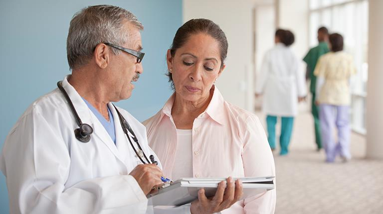 Woman talking with male doctor