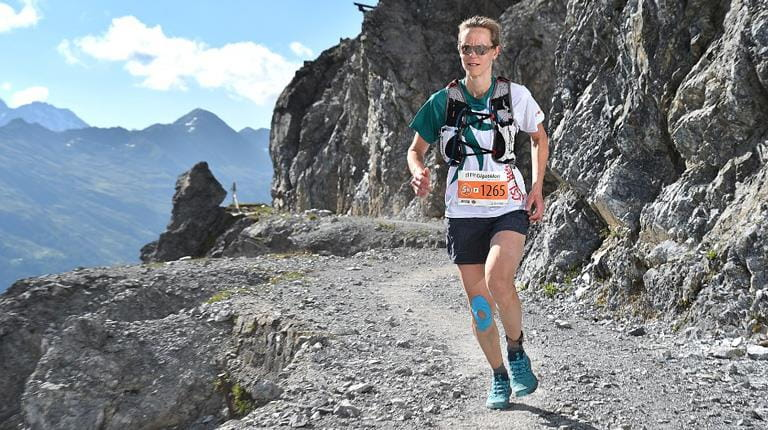 Karin Rezzonico runs through a trail in the Swiss Alps. Karin was one of 10 CSL Behring employees participating in the Arosa Gigathlon, a team building event the company competed in for the second year.