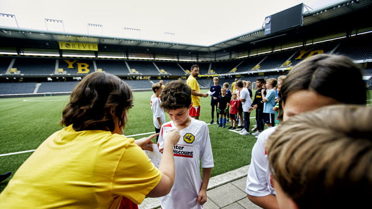 Bern children prepare to take the field at the Stade de Suisse