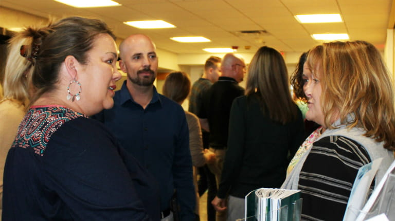 CSL Behring Patient Advocate Christie Hardin visiting with employees at the company's Kankakee, Illinois, site.