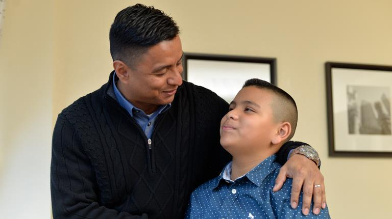 Hemophilia A patient Jonathan with his father, Hector.