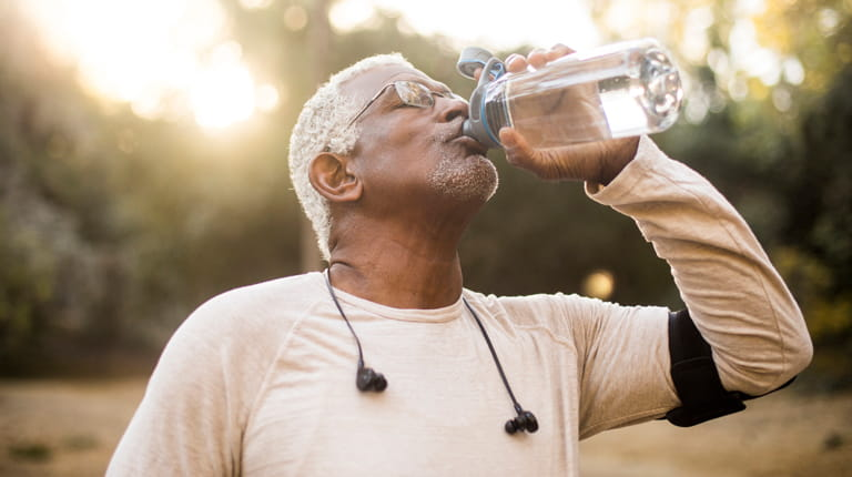 Man enjoying refreshing water after a workout