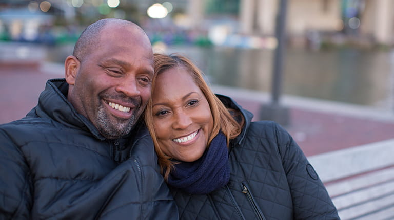 Cheryl Blackwell-Johnson and her husband, Michael, watching a sunset at the historic Baltimore Inner Harbor.