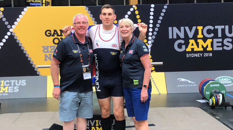 CSL Behring colleague Lesley Robertson poses with her powerlifter son, Paul Inman, who competed in the Invictus Game