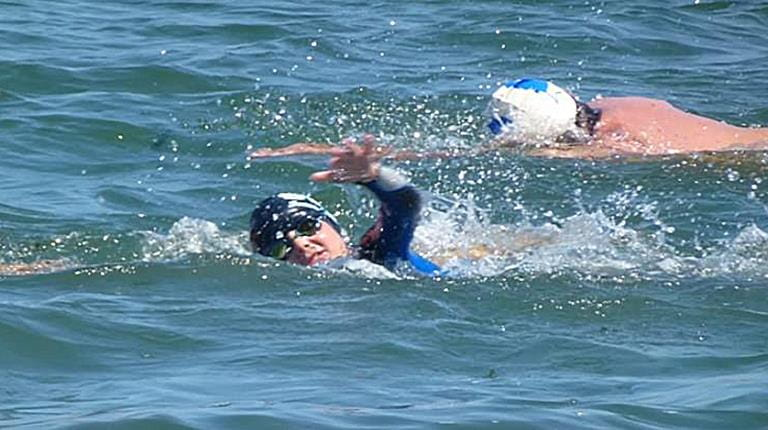 Rare disease patient James, who is living with hemophilia, during his swim from Alcatraz to San Francisco