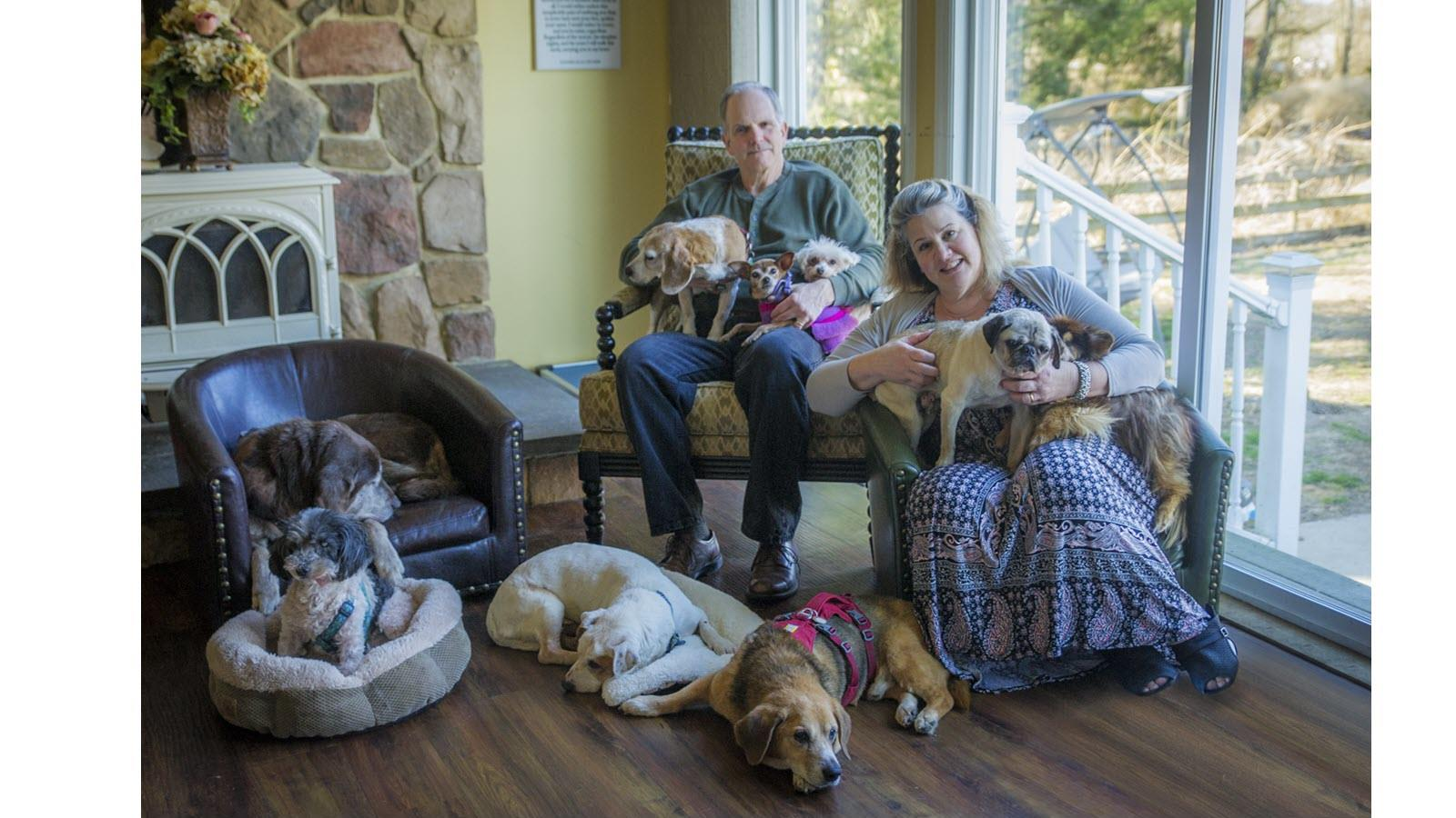 Jeff Allen and wife Michele surrounded by dogs they care for