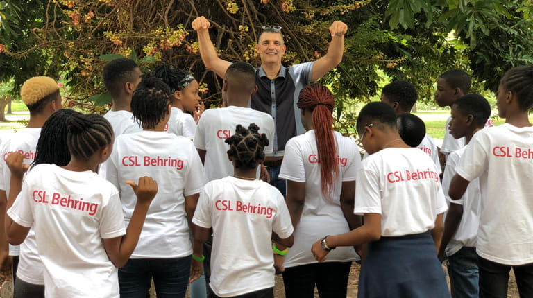 Jens Oltrogge with teenagers at sickle cell disease teen camp in Jamaica