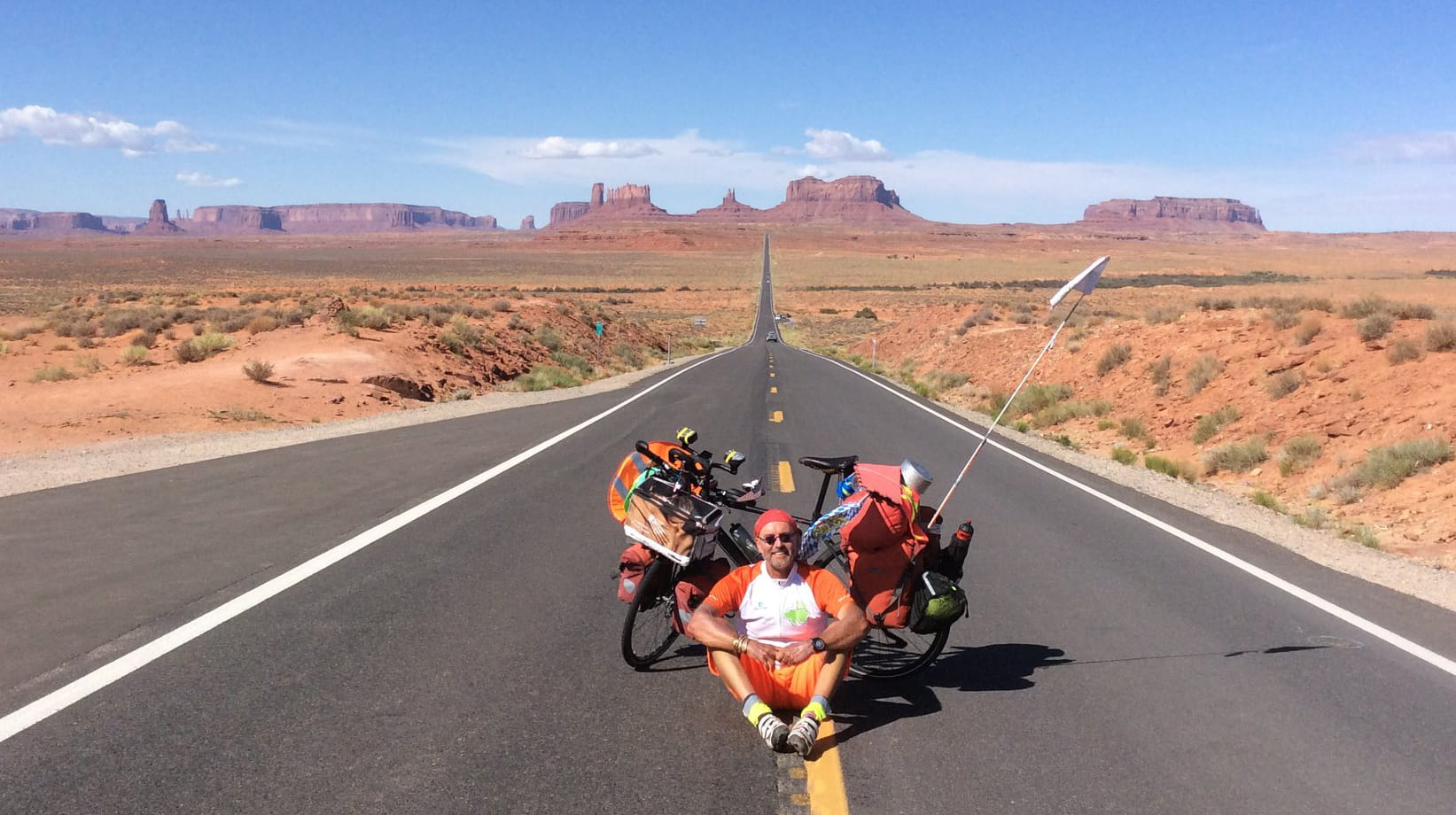 Jorg Richter takes a break from his 8,000 mile journey across the U.S. for a picture on a lonely road leading to Utah's Monument Valley. (Photo courtesy of Jorg Richter)