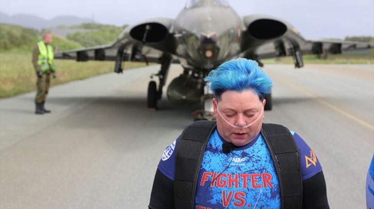 Wearing an oxygen tank to help her breathe and a harness to help her pull, strongwoman Karen Skalvoll recently broke two world records, pulling a MiG-15 and an F-104 Starfighter down an airport runway in Norway.
