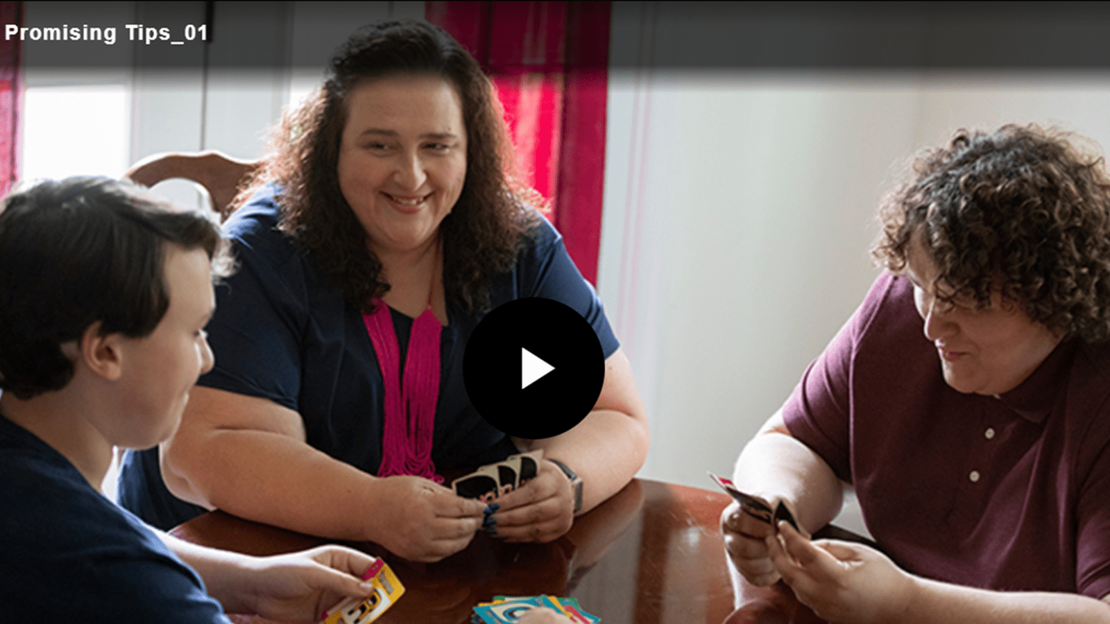 Machelle and her teen sons play a card game