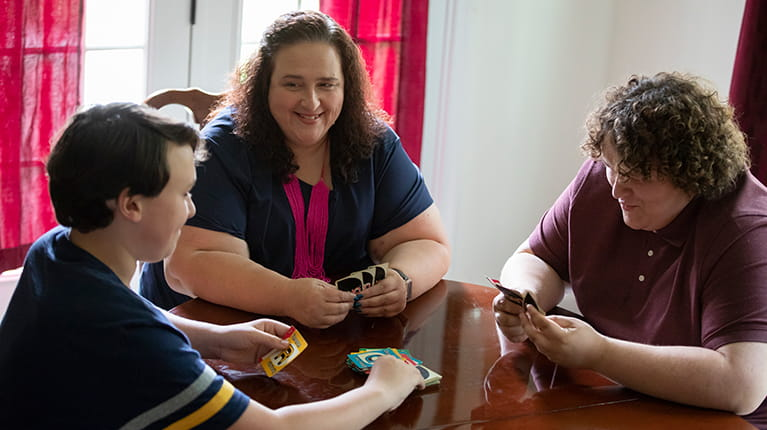 Hereditary angioedema patient Machelle Pecoraro playing cards with her children.