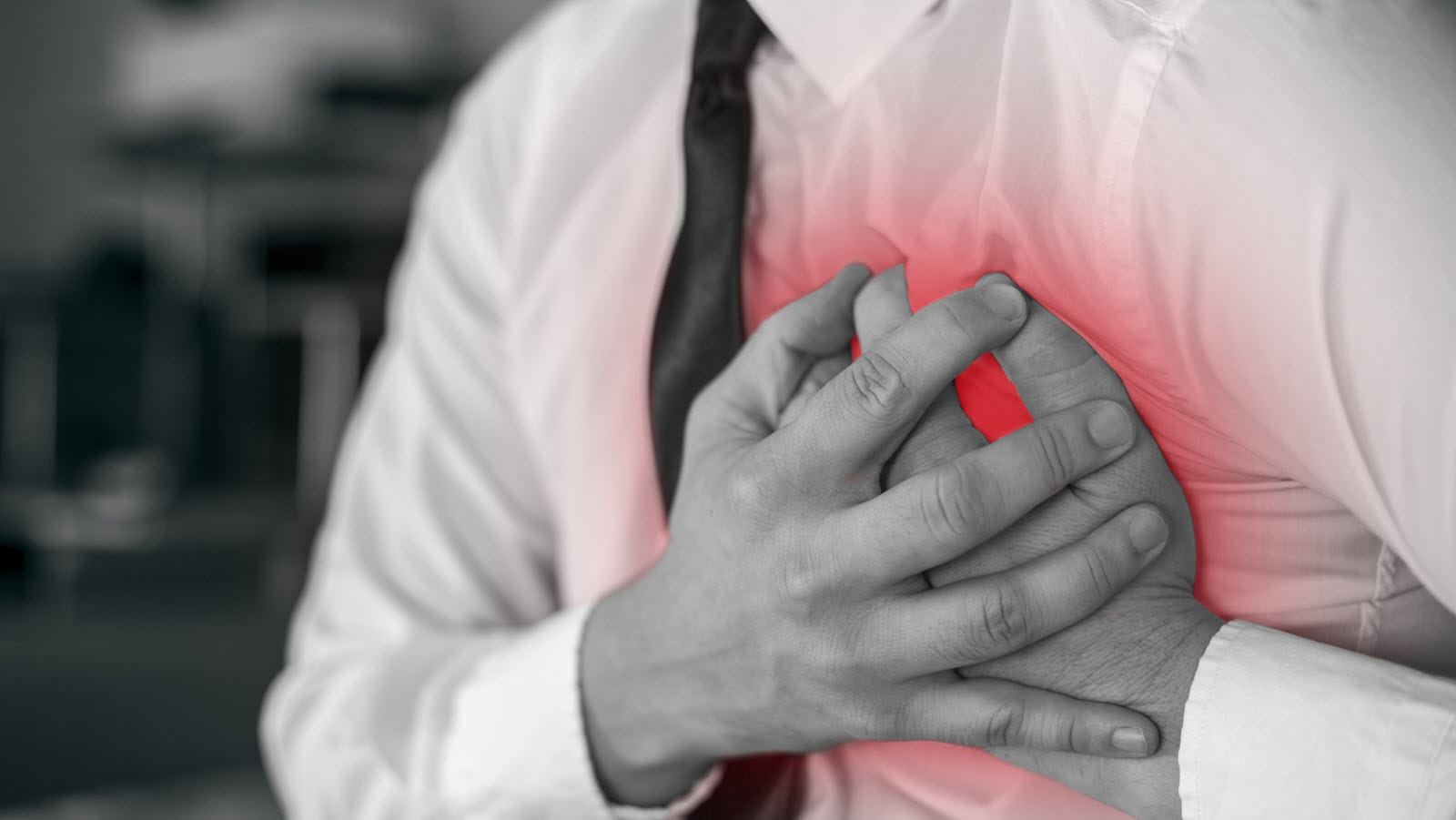 man clutching chest to illustrate a heart attack