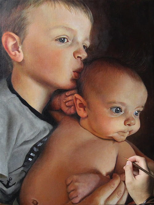 """Mason (left) and Miles Johannsen both have severe hemophilia A. Their portrait has been added to the """"Beyond the Diagnosis"""" exhibit of paintings of children with rare diseases. Artist Jota Leal's hand can be seen in the bottom right corner."""