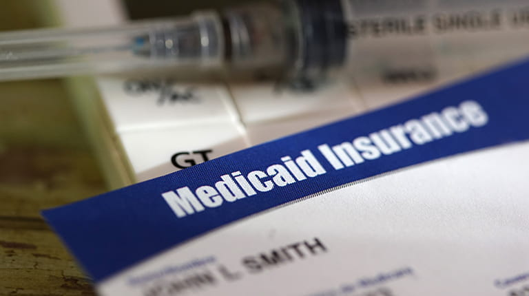 A close-up of a Medicaid insurance card.