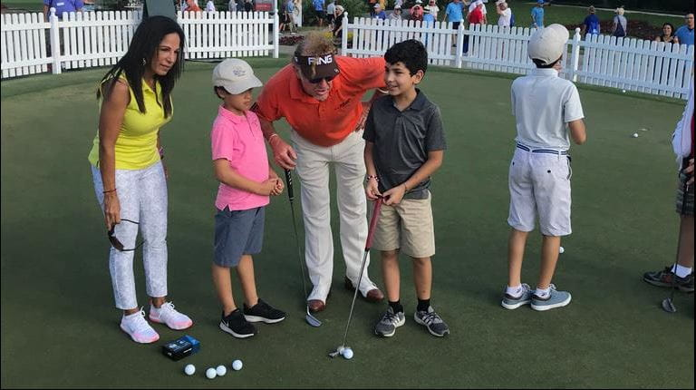 Miguel Angel Jimenez (center) works with participants at a putting clinic event for children with hemophilia at the Boca Raton Championship in Florida. The clinic was sponsored by CSL Plasma, which is based in Boca Raton.