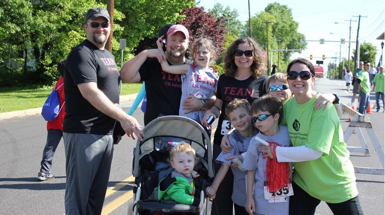 Author Margaret Mary Conger and her family during a fundraising walk.