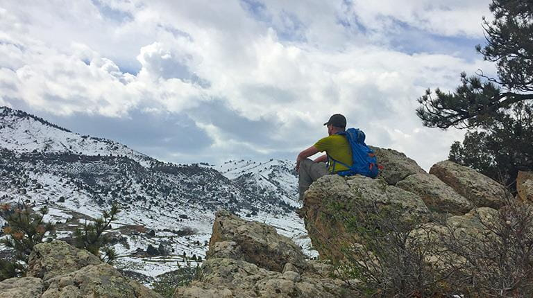 Tim Grams sitting quietly during a break on a hike near Denver