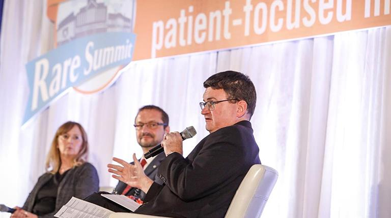 """Patrick Collins (right), Senior Director, Healthcare Policy and External Affairs, CSL Behring, moderated the panel, """"Value, Pricing & the Patient Experience: How to Achieve an Effective Balance,"""" at the NORD Rare Summit."""