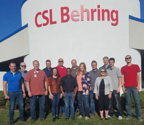 High school student apprentice Odell Jones and CSL Behring's Business Technology team in Kankakee, Illinois.