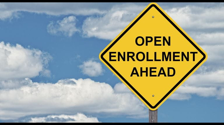 Traffic sign that says Open Enrollment (Getty Image)