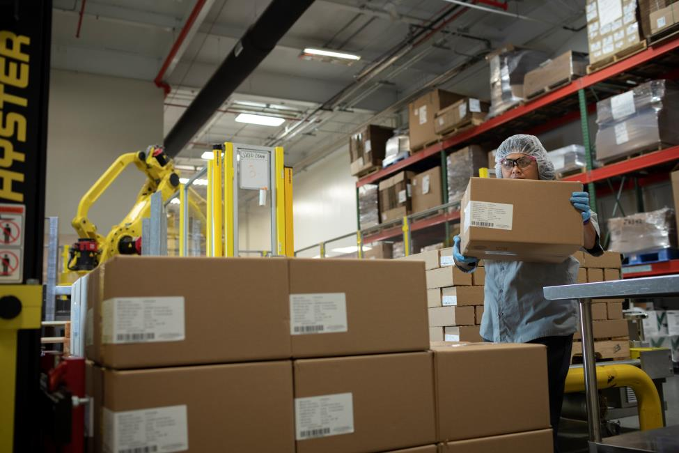 Workers package products at CSL Behring Kankakee, Illinois, manufacturing site