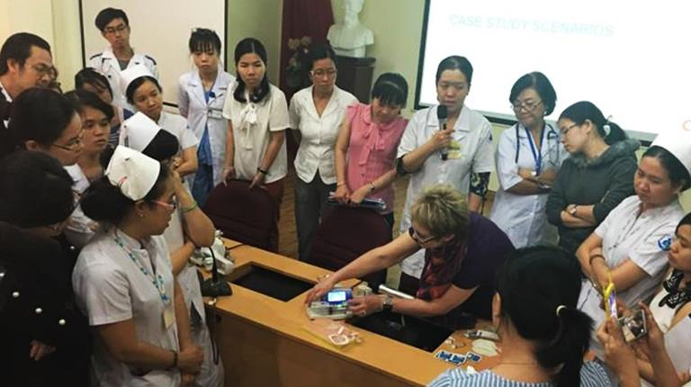 Patty Riley teaching students during a trip to Asia
