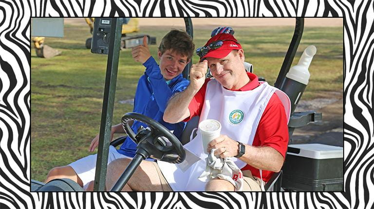 CSL CEO Paul Perreault golfing with a patient