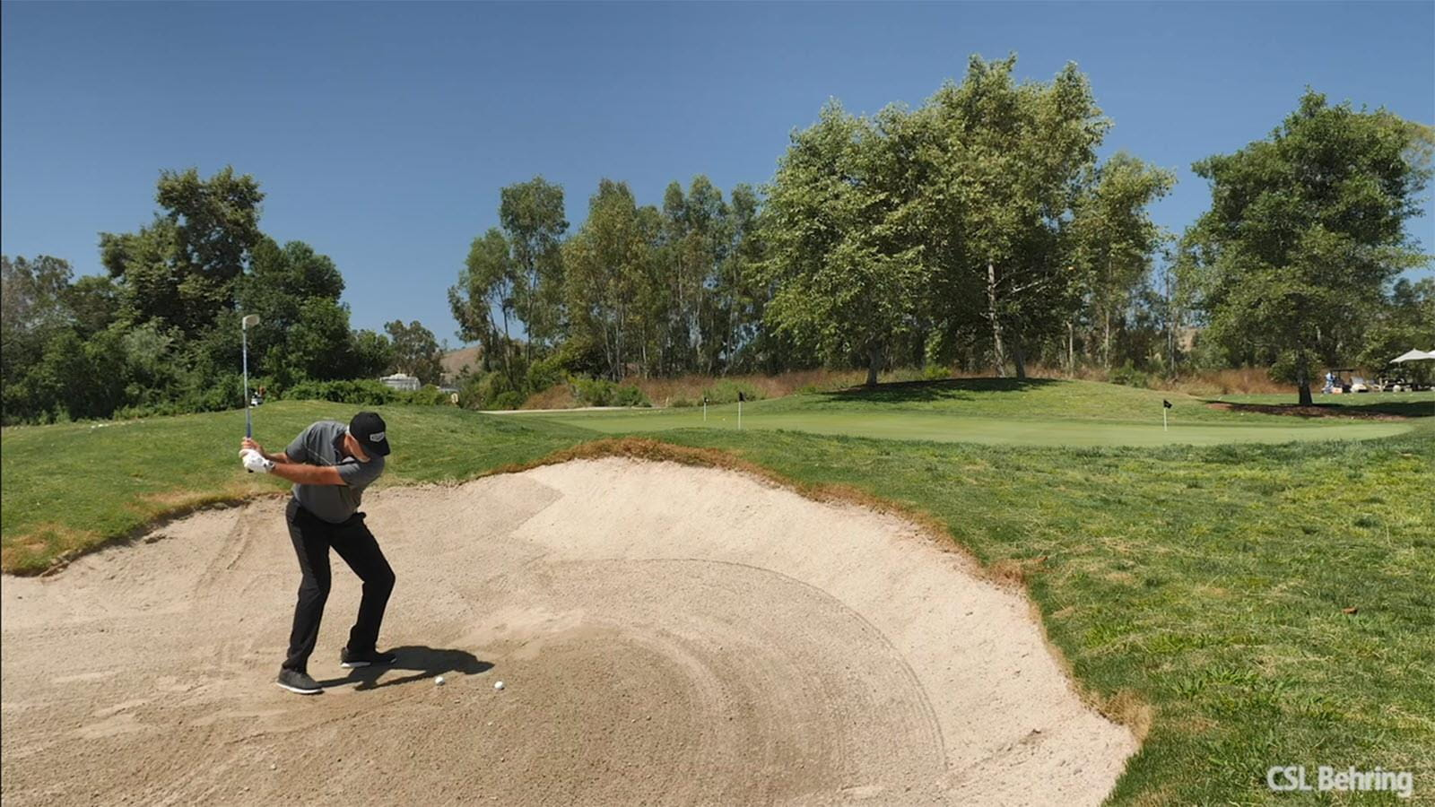 Golfer Perry Parker in a sand trap