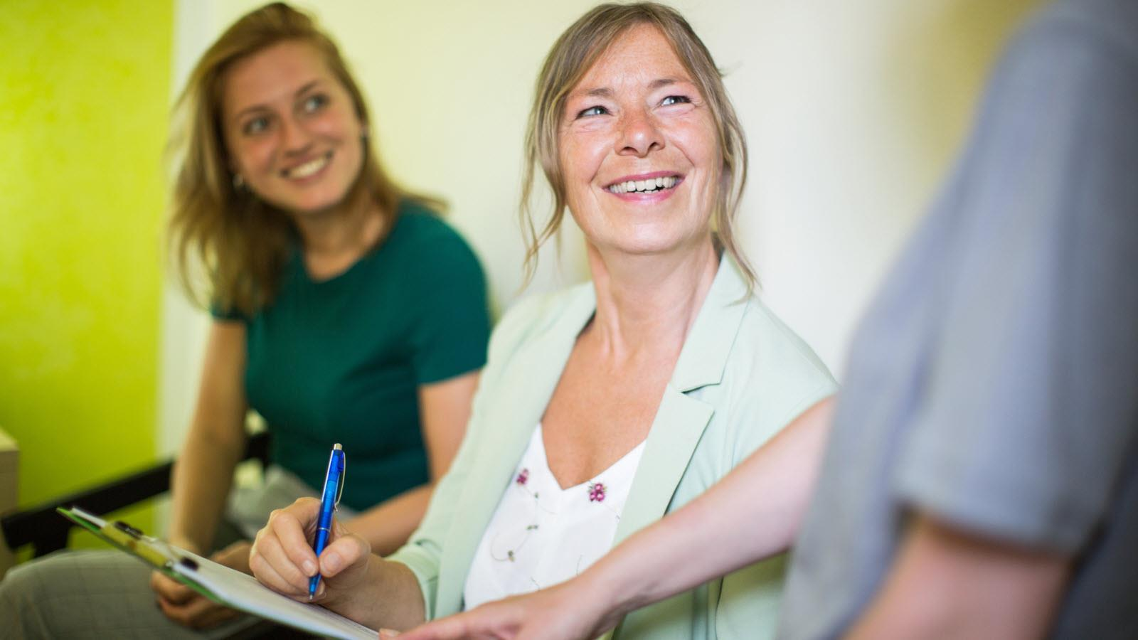 photo illustration of a women signing a document as part of a clinical trial