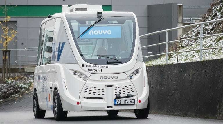 Self-driving bus drives down the road at CSL Behring's manufacturing facility in Marburg, Germany