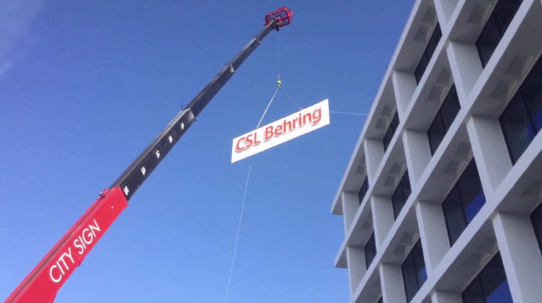 New CSL Behring sign going up at biotech leader's new soon-to-be-open office building in King of Prussia, Pa.