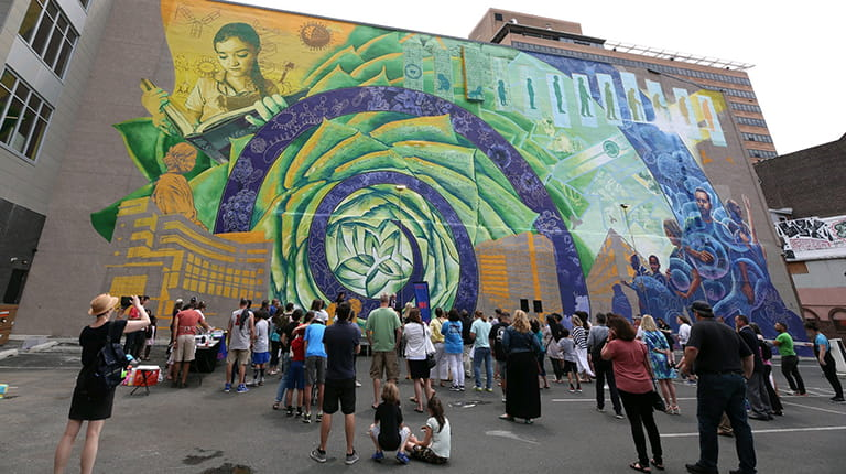 "A crowd gathered at the dedication of Mural Arts Philadelphia and CSL Behring's ""Promise of Biotechnology"" mural"