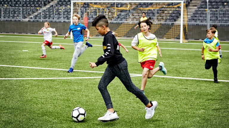 Player takes the ball in Stade de Suisse.